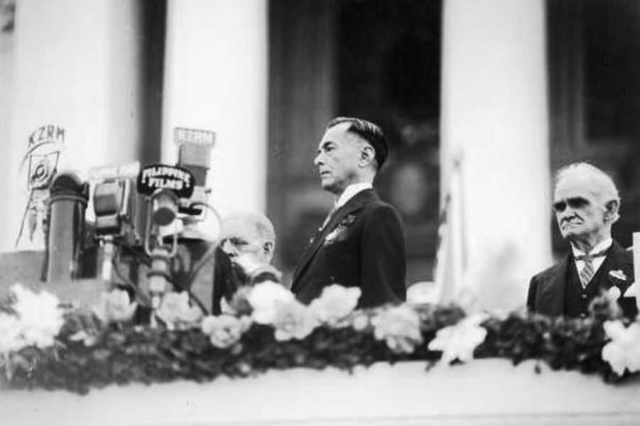Black and white photo of Manuel Quezon giving a speech